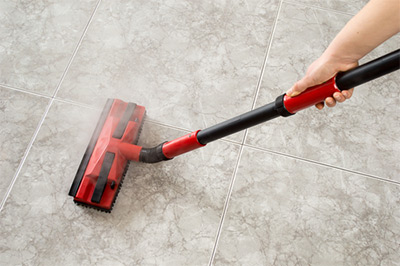 cleaning tile with a steamer
